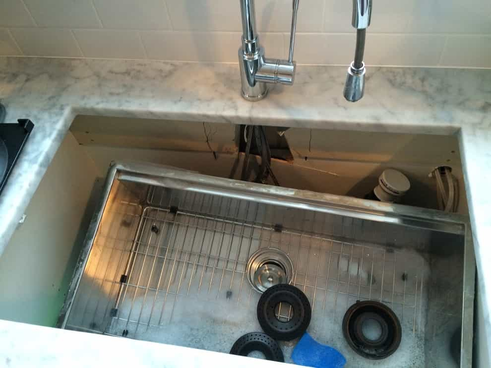 Undermount kitchen sink fallen inside counter due to no supports